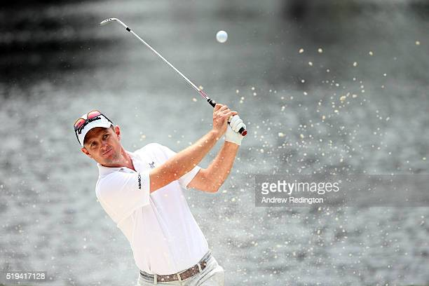 Justin Rose of England plays a shot from a bunker during the Par 3 Contest prior to the start of the 2016 Masters Tournament at Augusta National Golf...