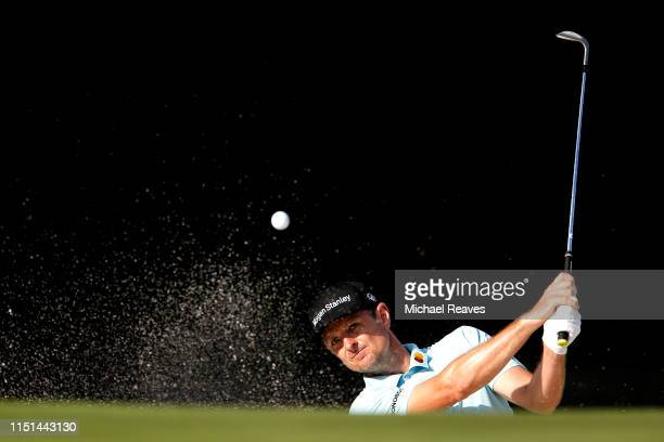 Justin Rose of England plays a shot from a bunker on the 11th hole during the second round of the Charles Schwab Challenge at Colonial Country Club...