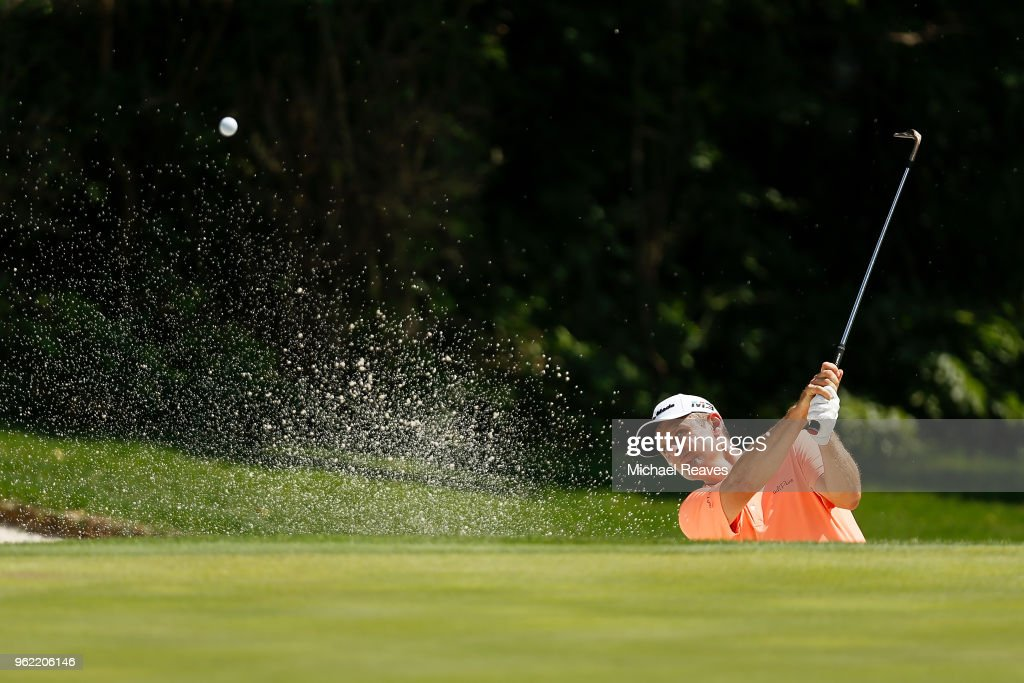 Justin Rose of England plays a shot from a bunker on the 11th hole during round one of the Fort Worth Invitational at Colonial Country Club on May 24, 2018 in Fort Worth, Texas.
