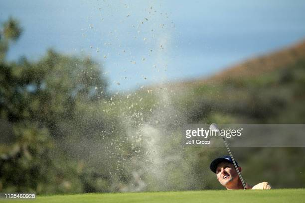 Justin Rose of England plays a shot from a bunker on the 13th hole on the South Course during the final round of the the 2019 Farmers Insurance Open...