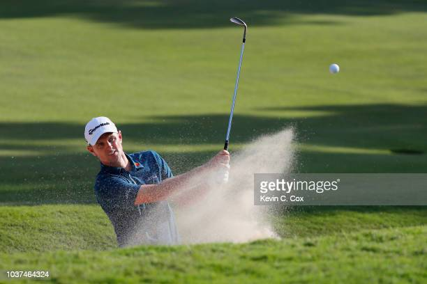 Justin Rose of England plays a shot from a bunker on the 17th hole during the second round of the TOUR Championship at East Lake Golf Club on...