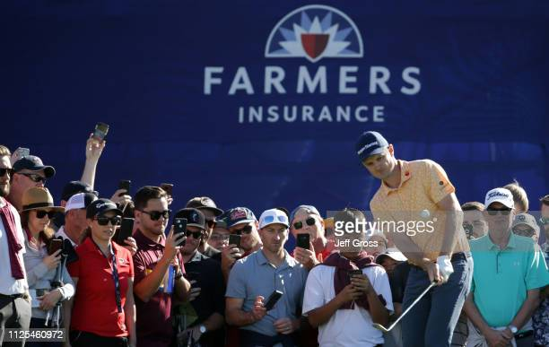 Justin Rose of England plays a shot from the rough on the 13th hole on the South Course during the final round of the the 2019 Farmers Insurance Open...
