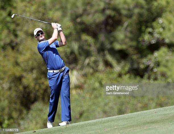 Justin Rose of England plays a shot on the 11th hole during the third round of the Transitions Championship at Innisbrook Resort and Golf Club on...