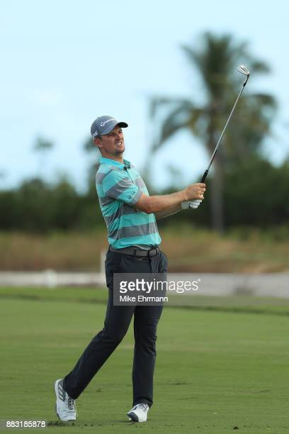 Justin Rose of England plays a shot on the 13th hole during the first round of the Hero World Challenge at Albany, Bahamas on November 30, 2017 in...