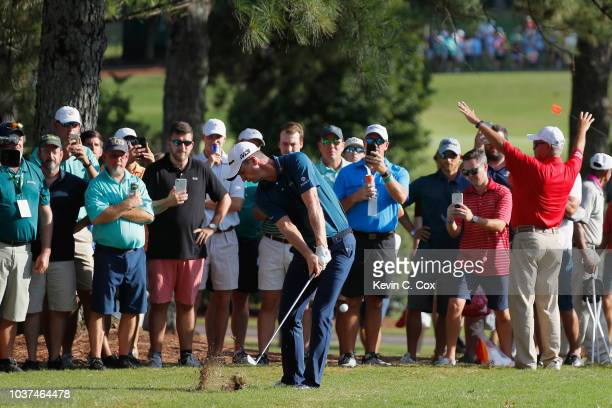 Justin Rose of England plays a shot on the 17th hole during the second round of the TOUR Championship at East Lake Golf Club on September 21 2018 in...