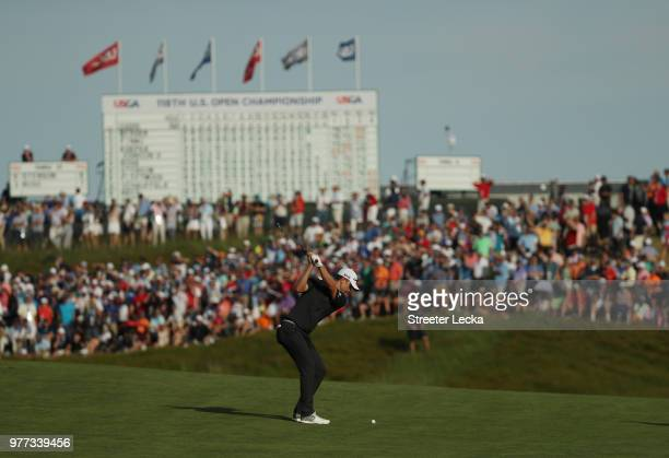 Justin Rose of England plays a shot on the 18th green during the final round of the 2018 US Open at Shinnecock Hills Golf Club on June 17 2018 in...