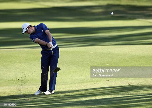 Justin Rose of England plays a shot on the 18th hole during the third round of the Transitions Championship at Innisbrook Resort and Golf Club on...