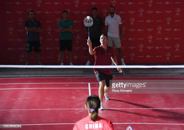 Justin Rose of England plays badminton during a photocall prior to the WGC HSBC Champtions at the Chamber of Commerce Shanghai on October 23 2018 in...