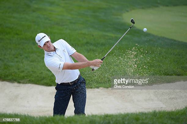 Justin Rose of England plays from a bunker on the fourth hole during the final round of the Memorial Tournament presented by Nationwide at Muirfield...