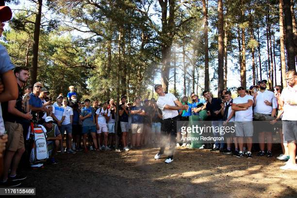 Justin Rose of England plays his second shot on the 10th hole during Day Three of the BMW PGA Championship at Wentworth Golf Club on September 21,...