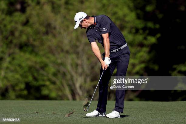 Justin Rose of England plays his second shot on the 11th hole during the final round of the 2017 Masters Tournament at Augusta National Golf Club on...