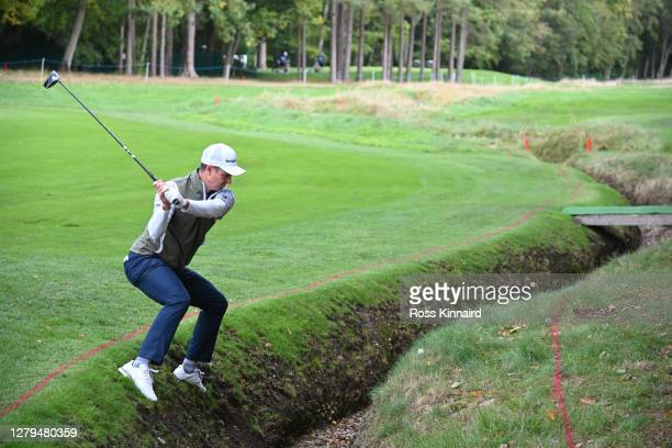 Justin Rose of England plays his second shot on the 15th hole during Day Three of the BMW PGA Championship at Wentworth Golf Club on October 10, 2020...