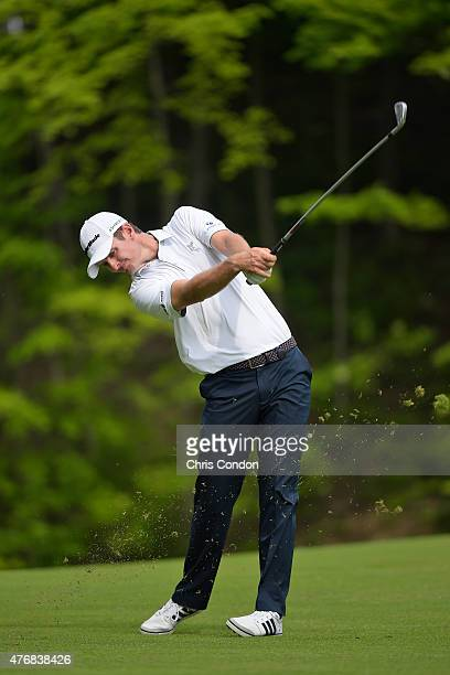 Justin Rose of England plays his second shot on the 15th hole during the final round of the Memorial Tournament presented by Nationwide at Muirfield...
