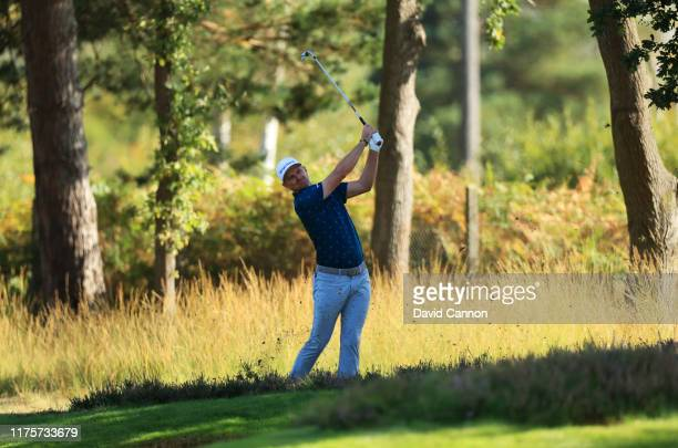 Justin Rose of England plays his second shot on the 9th hole during Day One of the BMW PGA Championship at Wentworth Golf Club on September 19 2019...