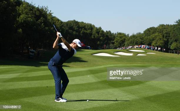 Justin Rose of England plays his second shot on the fifth hole during the final round of the WGC HSBC Champions at Sheshan International Golf Club on...