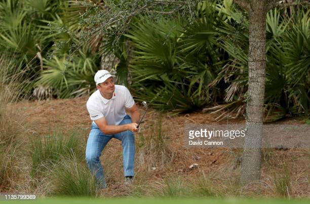 Justin Rose of England plays his second shot on the par 4 10th hole during the first round of the 2019 Players Championship held on the Stadium...