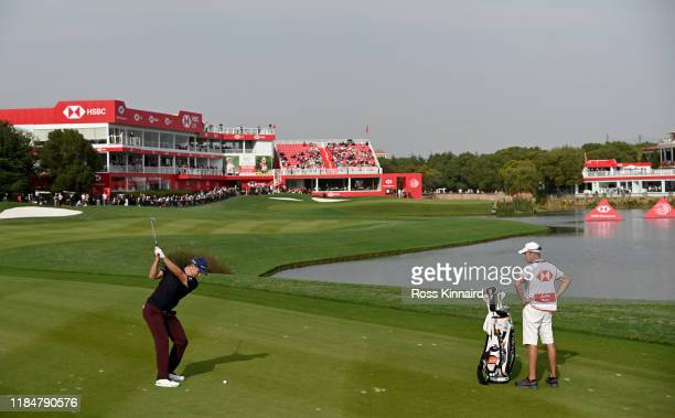 Justin Rose of England plays his second shot on the par five 18th hole during the second round of the WGC HSBC Champions at Sheshan International...