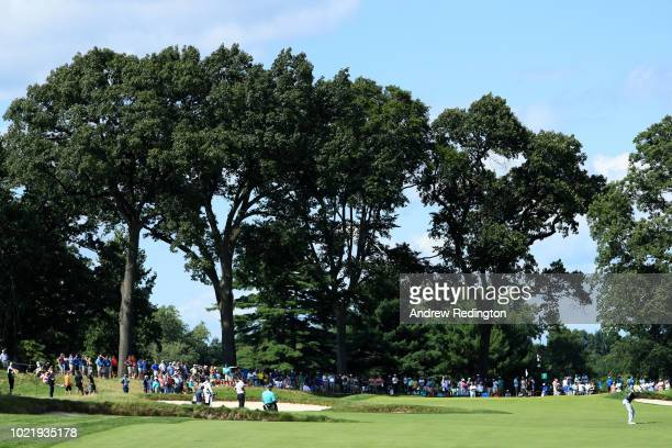 Justin Rose of England plays his second shot on the seventh hole during the first round of The Northern Trust on August 23 2018 at the Ridgewood...