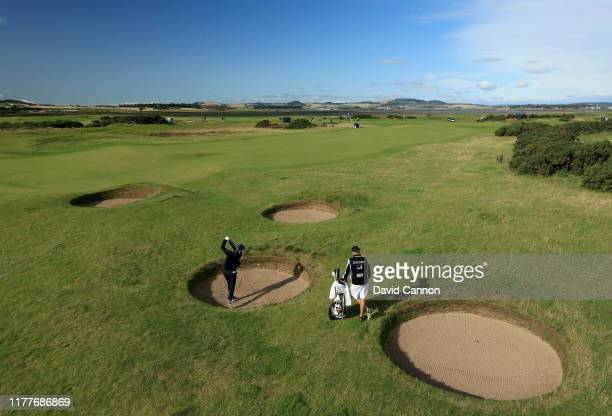 Justin Rose of England plays his second shot on the sixth hole where he failed to escape the bunker during the third round of the Alfred Dunhill...