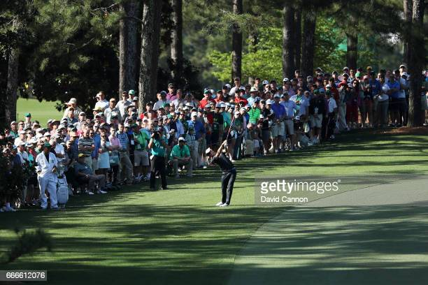 Justin Rose of England plays his second shot on the tenth hole during the final round of the 2017 Masters Tournament at Augusta National Golf Club on...