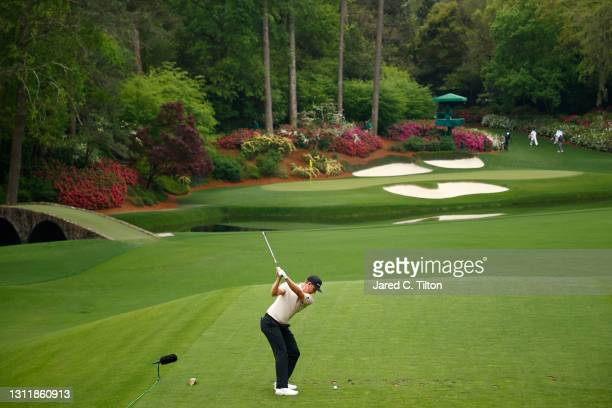 Justin Rose of England plays his shot from the 12th tee during the third round of the Masters at Augusta National Golf Club on April 10, 2021 in...