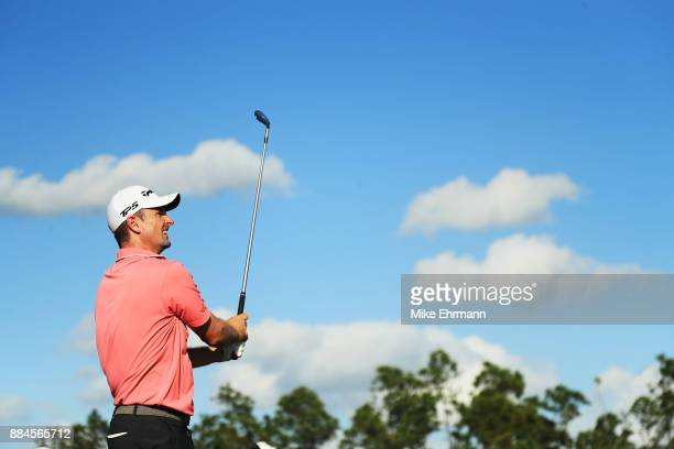 Justin Rose of England plays his shot from the 12th tee during the third round of the Hero World Challenge at Albany Bahamas on December 2 2017 in...