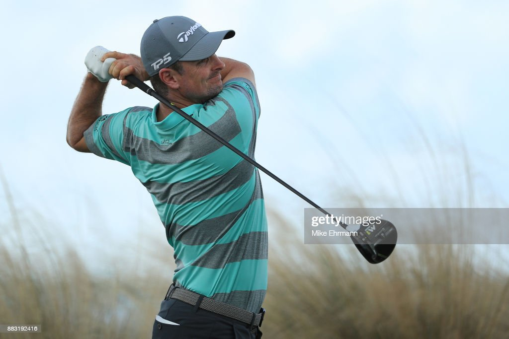 Justin Rose of England plays his shot from the 14th tee during the first round of the Hero World Challenge at Albany, Bahamas on November 30, 2017 in Nassau, Bahamas.