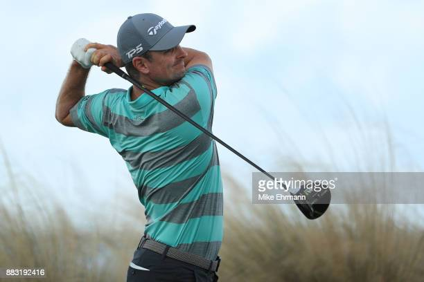 Justin Rose of England plays his shot from the 14th tee during the first round of the Hero World Challenge at Albany Bahamas on November 30 2017 in...