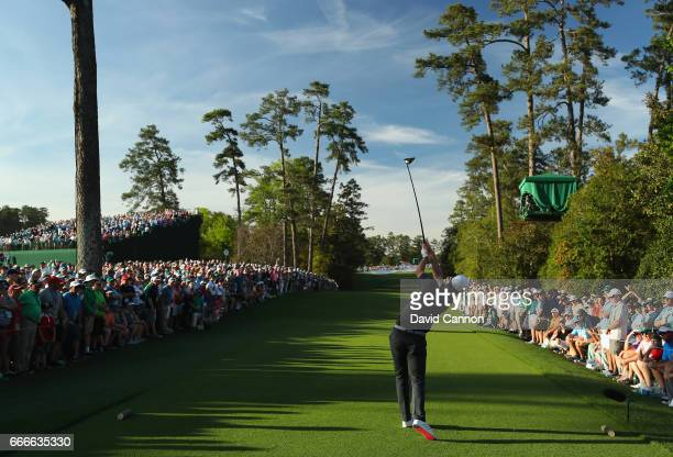 Justin Rose of England plays his shot from the 18th tee during the final round of the 2017 Masters Tournament at Augusta National Golf Club on April...