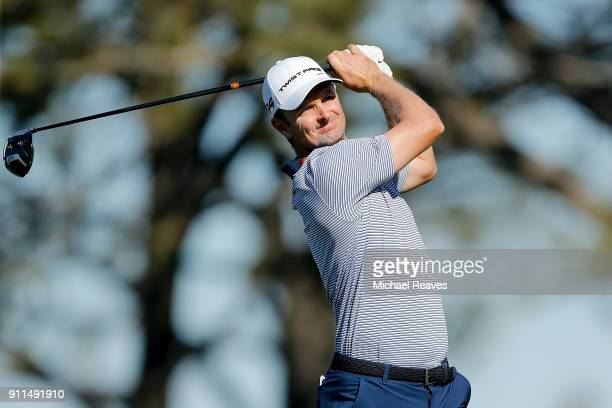 Justin Rose of England plays his shot from the fifth tee during the final round of the Farmers Insurance Open at Torrey Pines South on January 28...