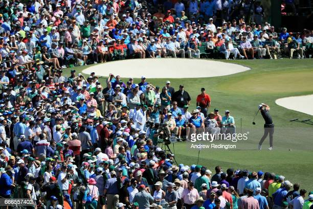 Justin Rose of England plays his shot from the third tee as patrons look on during the final round of the 2017 Masters Tournament at Augusta National...