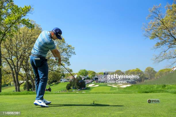 Justin Rose of England plays his tee shot on the 18th hole during the first round of the 2019 PGA Championship on the Black Course at Bethpage State...