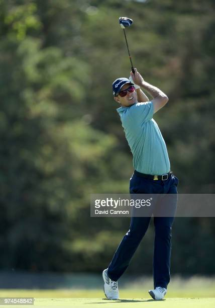 Justin Rose of England plays his tee shot on the sixth hole during the first round of the 2018 US Open at Shinnecock Hills Golf Club on June 14 2018...