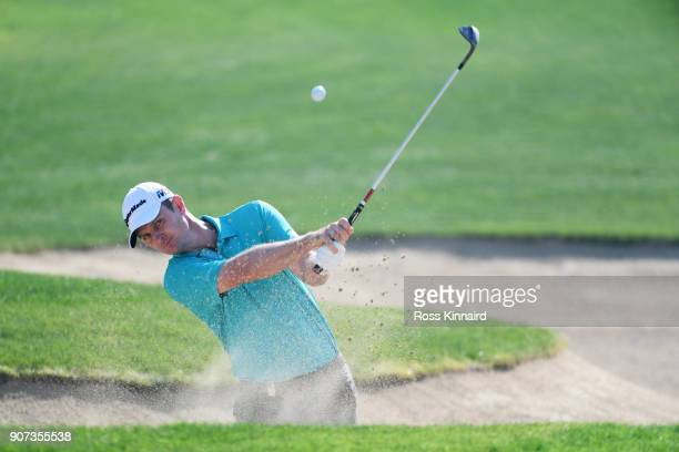 Justin Rose of England plays his third shot from a bunker on the eighth hole during round three of the Abu Dhabi HSBC Golf Championship at Abu Dhabi...