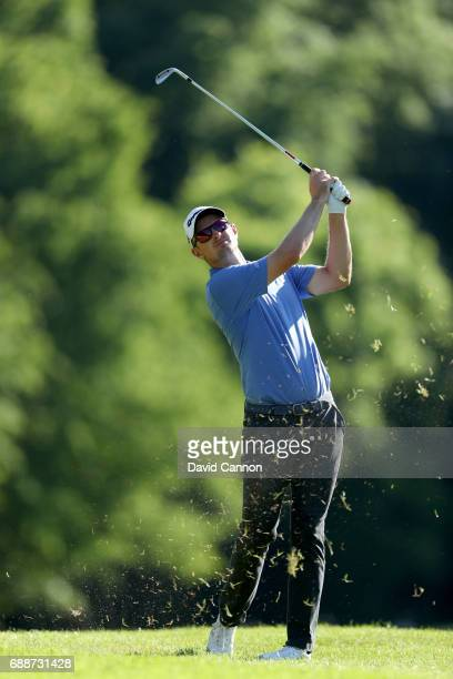 Justin Rose of England plays his third shot on the par 5 17th hole during the second round of the 2017 BMW PGA Championship on the West Course at...