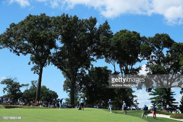 Justin Rose of England plays his third shot on the seventh hole during the first round of The Northern Trust on August 23 2018 at the Ridgewood...