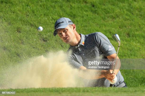 Justin Rose of England plays out of a bunker on the 3rd during the BMW PGA Championship ProAM at Wentworth on May 24 2017 in Virginia Water England