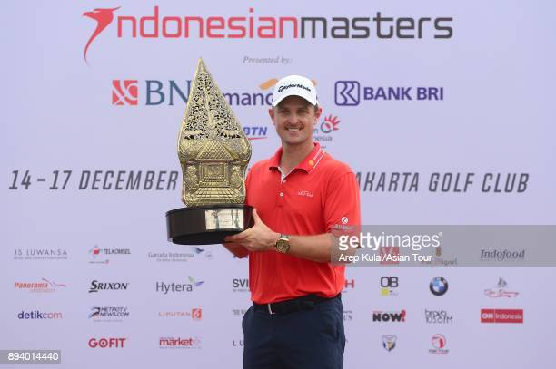 Justin Rose of England pose with the trophy after winning the 2017 Indonesian Masters at Royale Jakarta Golf Club on December 17 2017 in Jakarta...