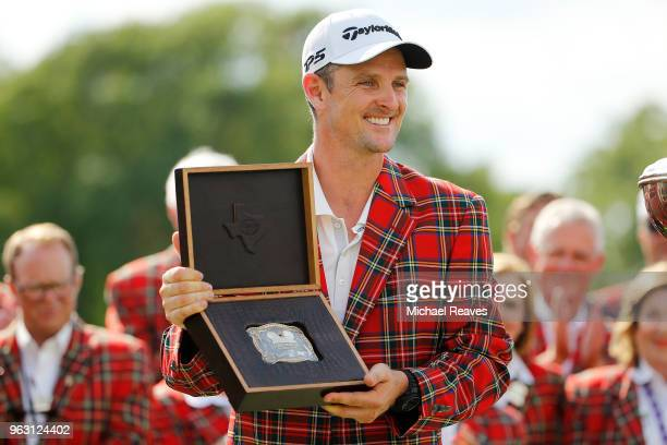 Justin Rose of England poses with a trophy belt buckle after winning the Fort Worth Invitational at Colonial Country Club on May 27 2018 in Fort...