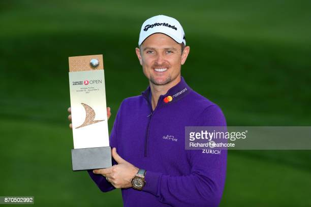 Justin Rose of England poses with the trophy after his victory during the final round of the Turkish Airlines Open at the Regnum Carya Golf Spa...
