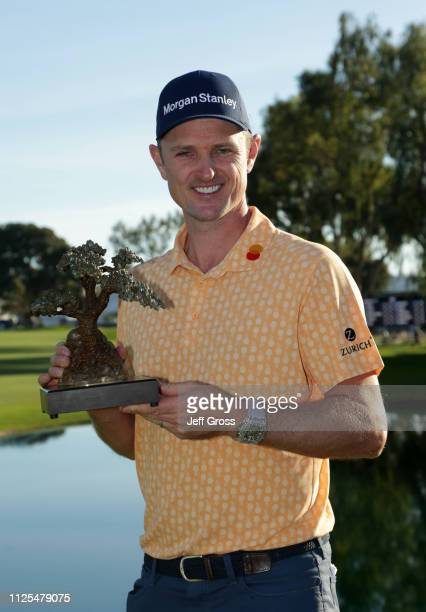 Justin Rose of England poses with the trophy after winning on the South Course during the final round of the the 2019 Farmers Insurance Open at...