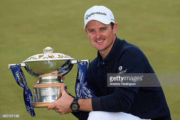 Justin Rose of England poses with the trophy after winning the Aberdeen Asset Management Scottish Open at Royal Aberdeen on July 13 2014 in Aberdeen...