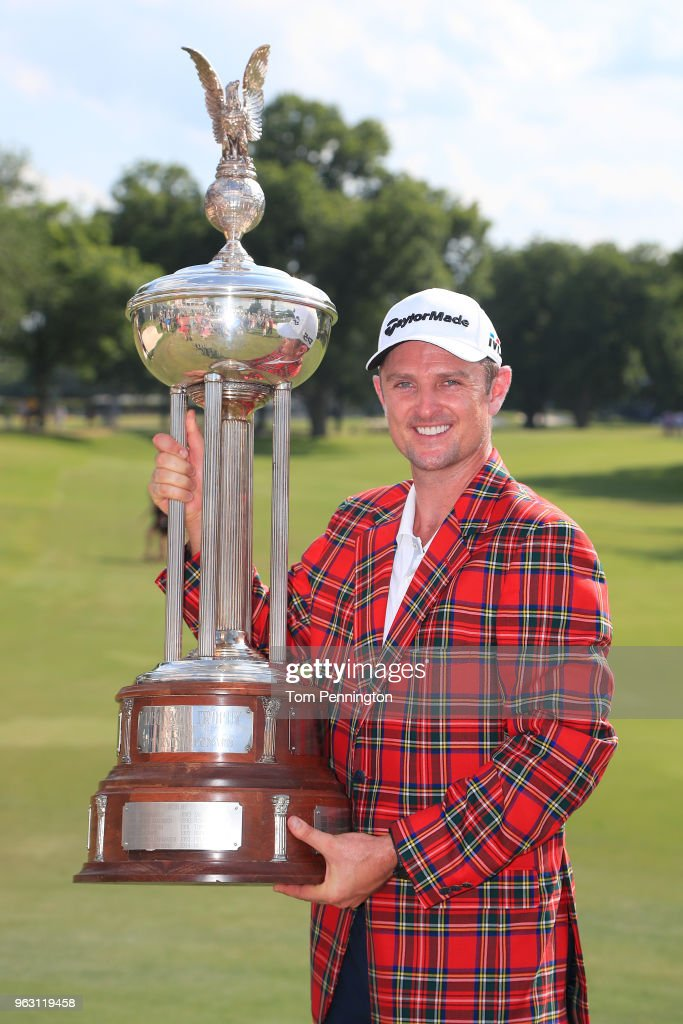 Justin Rose of England poses with the trophy after winning the Fort Worth Invitational at Colonial Country Club on May 27, 2018 in Fort Worth, Texas.