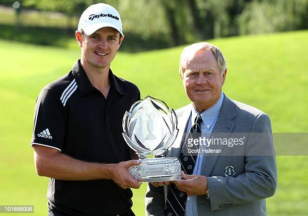 Justin Rose of England poses with the trophy alongside tournament host Jack Nicklaus after his threestroke victory at the Memorial Tournament...