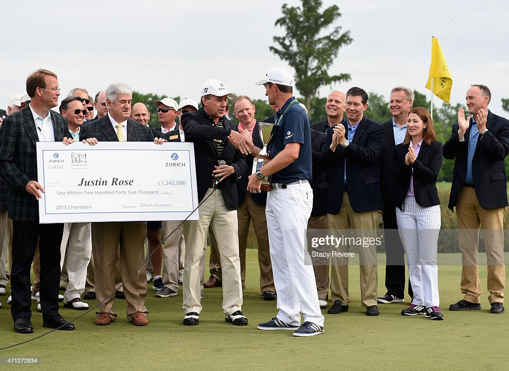 Justin Rose of England poses with the trophy and Zurich executives after winning the Zurich Classic of New Orleans at TPC Louisiana on April 26, 2015 in Avondale, Louisiana.