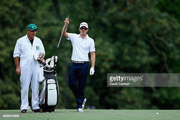 Justin Rose of England pulls a club during the final round of the 2015 Masters Tournament at Augusta National Golf Club on April 12 2015 in Augusta...