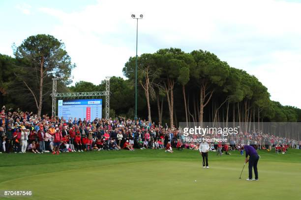 Justin Rose of England putts for birdie on the 18th green during the final round of the Turkish Airlines Open at the Regnum Carya Golf Spa Resort on...