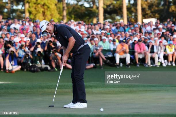 Justin Rose of England putts for birdie on the first playoff hole during the final round of the 2017 Masters Tournament at Augusta National Golf Club...