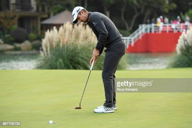 Justin Rose of England putts ofr par on the 18th green during the final round of the WGC HSBC Champions at Sheshan International Golf Club on October...