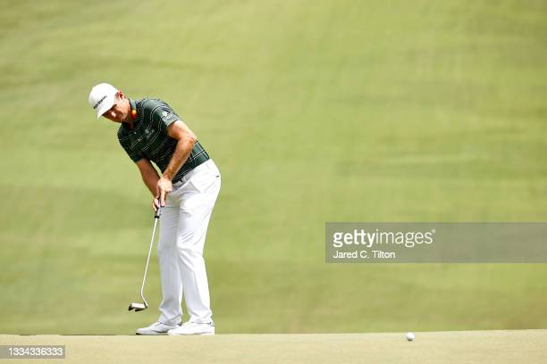 Justin Rose of England putts on the 18th green during the final round of the Wyndham Championship at Sedgefield Country Club on August 15, 2021 in...